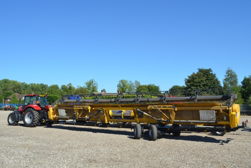 Trailer for widest combine cutterbars
